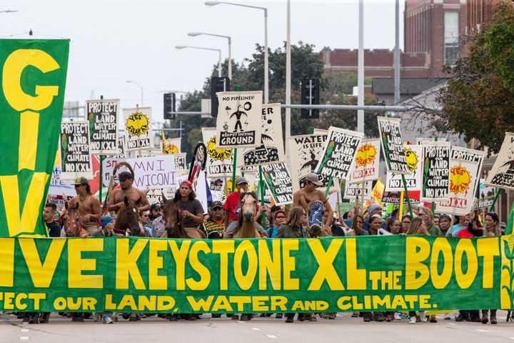 In this Aug. 6, 2017, file photo, demonstrators against the Keystone XL pipeline march in Lincoln, Neb.