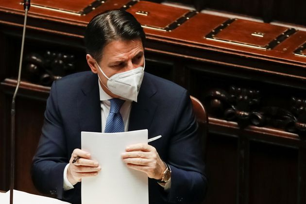 Italy's Prime Miniser Giuseppe Conte holds the papers prior to delivering his speech at the lower chamber...