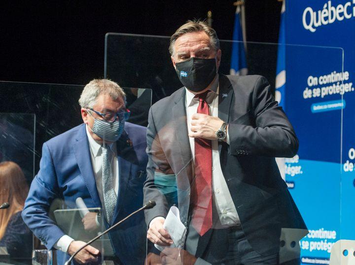 François Legault (droite) avait indiqué en octobre dernier que les recommandations du Dr Arruda (gauche) étaient surtout faites à l'oral. (photo d'archives)
