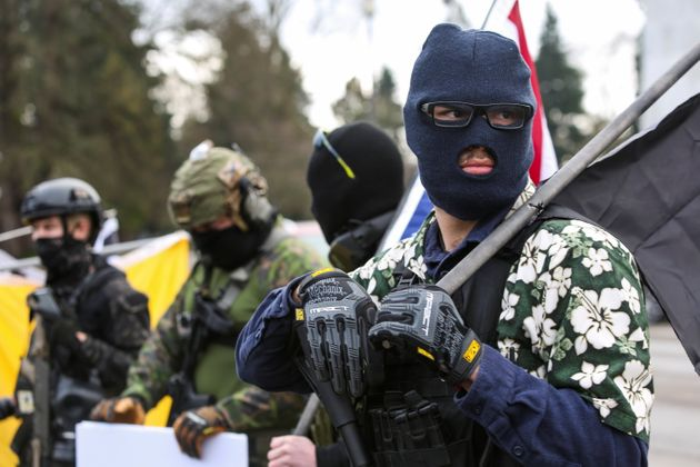 An armed group, who identify as