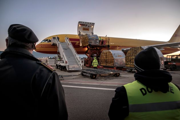 Pfizer-BionTech vaccine supplies arriving in the early morning at the international airport of Pisa,...