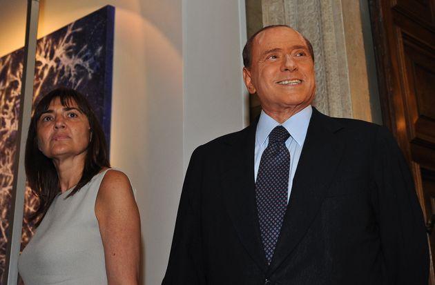 Italian Prime Minister Silvio Berlusconi looks on next to the President of the Lazio region Renata Polverini...