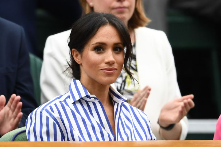 The Duchess of Sussex attends day twelve of the Wimbledon Lawn Tennis Championships on July 14, 2018 in London.