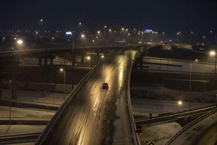 A lone vehicle drives on the Turcot Interchange in Montreal on Jan. 11, 2021. Quebec imposed a month-long curfew across the province earlier this month.