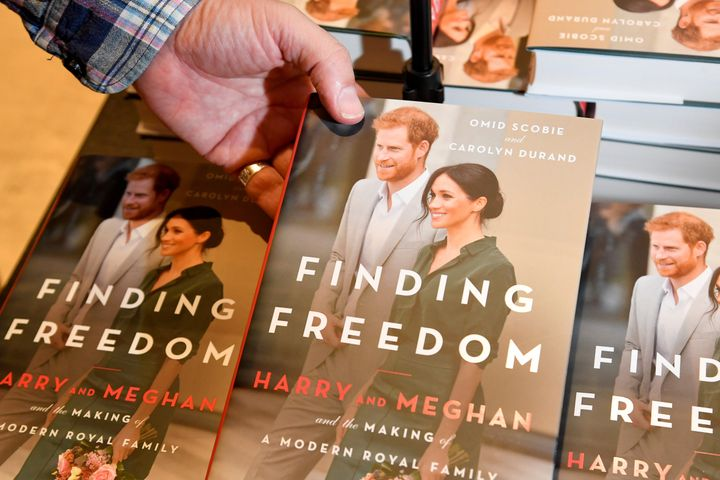 An employee holds a copy of 'Finding Freedom', an unofficial biography on Prince Harry and Meghan, the Duchess of Sussex, at