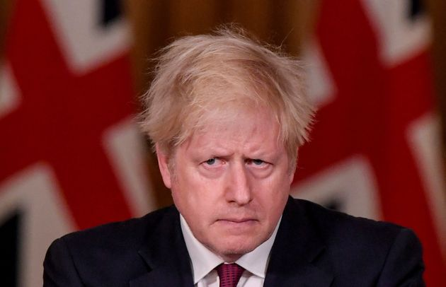 Prime Minister Boris Johnson looks on during a news conference in response to the ongoing situation with...