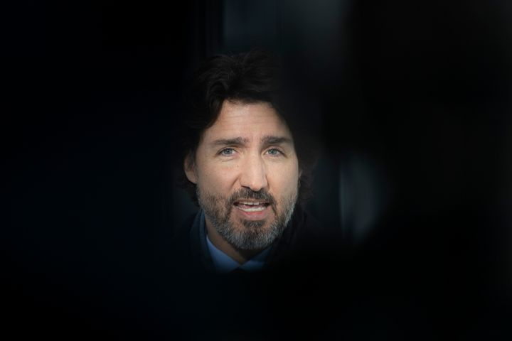 Prime Minister Justin Trudeau delivers his opening remarks at a news conference outside Rideau cottage in Ottawa on Jan. 19, 2021.