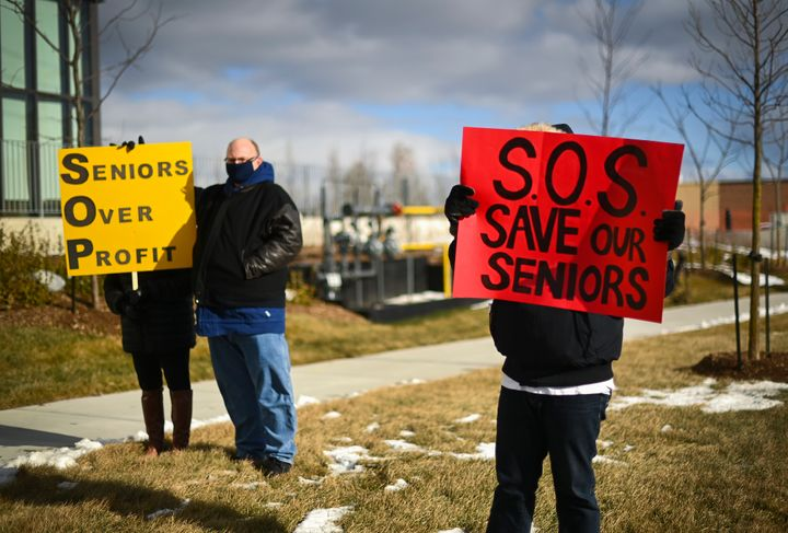 People protest outside the Tendercare Living Centre long-term-care facility during the COVID-19 pandemic in Scarborough, Ont., on Dec. 29, 2020. This LTC home has been hit hard by the coronavirus during the second wave.