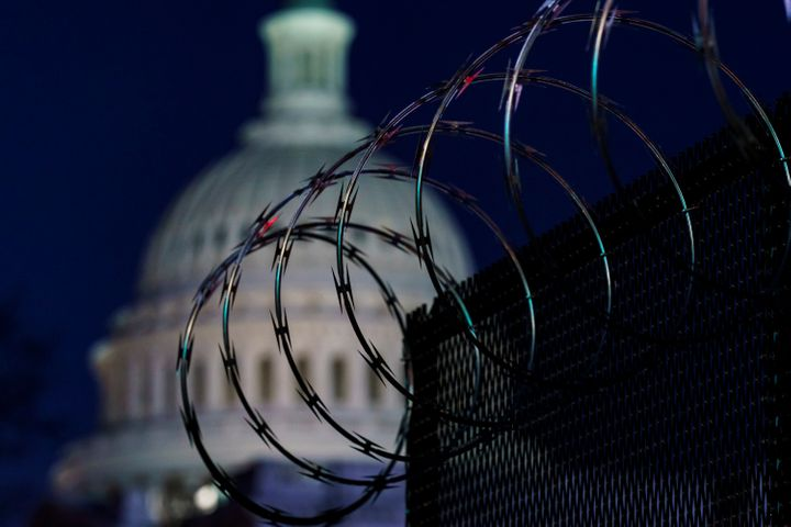 Riot fencing and razor wire reinforce the security zone on Capitol Hill in Washington on Tuesday, the day before Joe Biden's