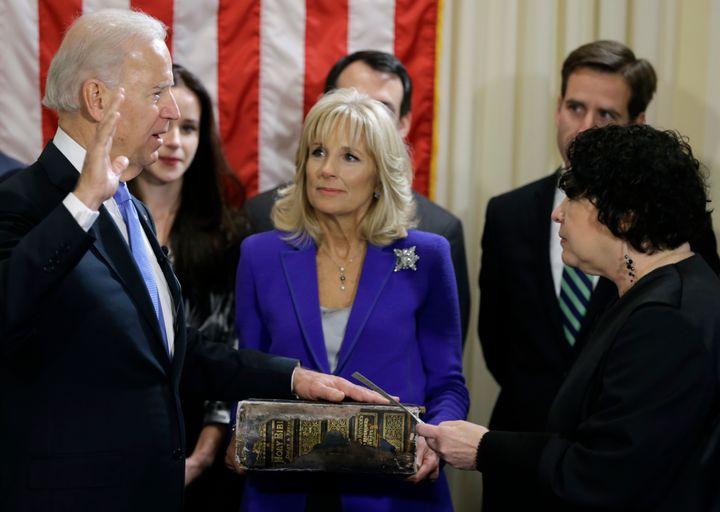Jill Biden holds the Biden family Bible as then-Vice President Joe Biden takes the oath of office on Jan. 20, 2013, in Washin