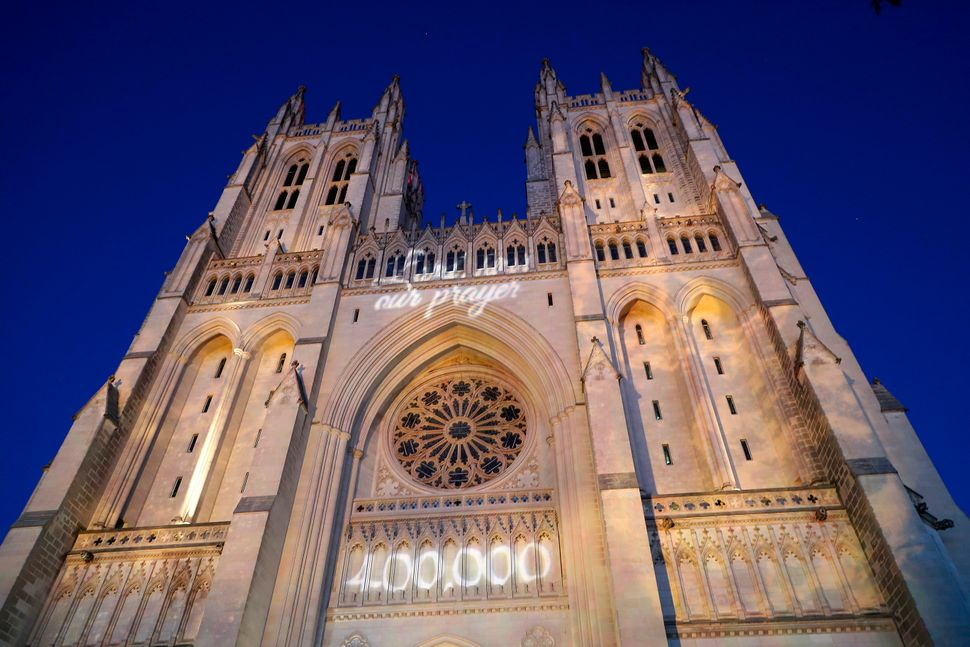 The grim COVID-19 milestone was projected onto the National Cathedral to honor the pandemic's victims.