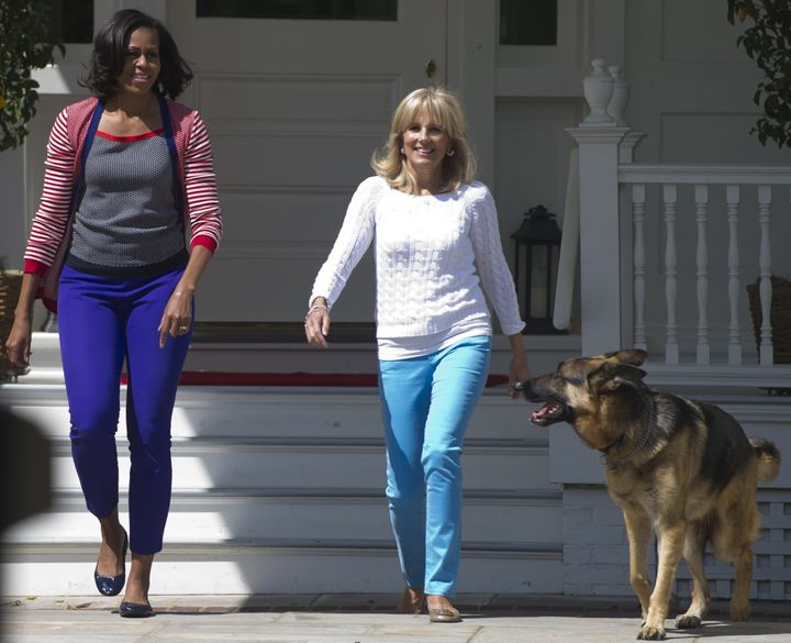 Michelle Obama, Jill Biden and Champ arrive to help assemble Mother's Day packages that deployed U.S. troops requested to be sent to their mothers and wives at home at the Naval Observatory in May 2012.