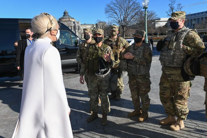 Lady Gaga, left, greets National Guard soldiers after rehearsing on Tuesday for the inauguration of President-elect Joe Biden