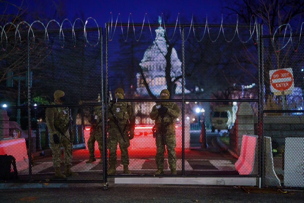 National Guard troops reinforce the security zone on Capitol Hill in Washington, on Tuesday.