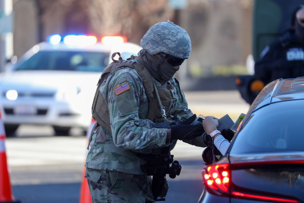 Police and National Guard soldiers at a checkpoint near the U.S. Capitol Building on Tuesday.