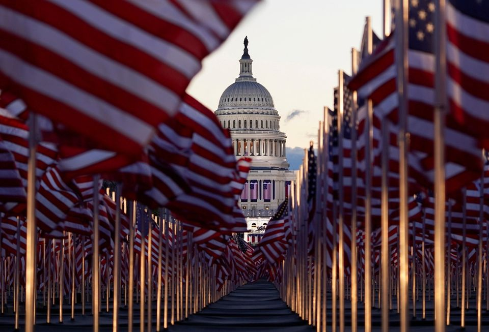 """The """"Field of flags"""" is seen on the National Mall in front of the U.S. Capitol building ahead of inauguration ceremonies for President-elect Joe Biden in Washington, U.S., January 20, 2021. REUTERS/Allison Shelley     TPX IMAGES OF THE DAY"""