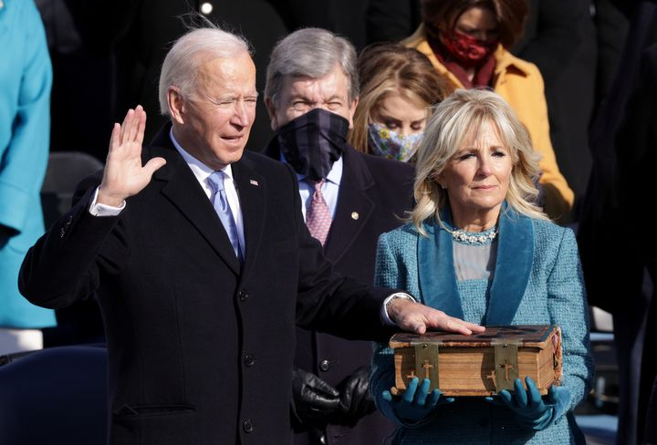 Joe Biden is sworn in as U.S. President as his wife Dr. Jill Biden looks on during his inauguration on the West Front of the U.S. Capitol on January 20, 2021 in Washington, DC. During today's inauguration ceremony Joe Biden becomes the 46th president of the United States. (Photo by Alex Wong/Getty Images)