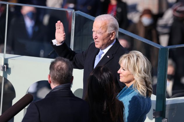 Joe Biden is sworn in as US president as his wife Dr Jill Biden looks on during his inauguration on the...