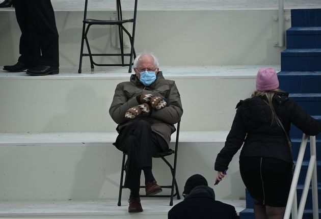 Senator Bernie Sanders sits in the bleachers on Capitol Hill before Joe Biden is sworn in as the 46th...