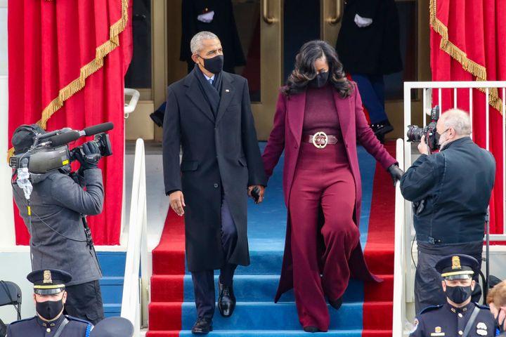 Former President Barack Obama and former first lady Michelle Obama arrive.