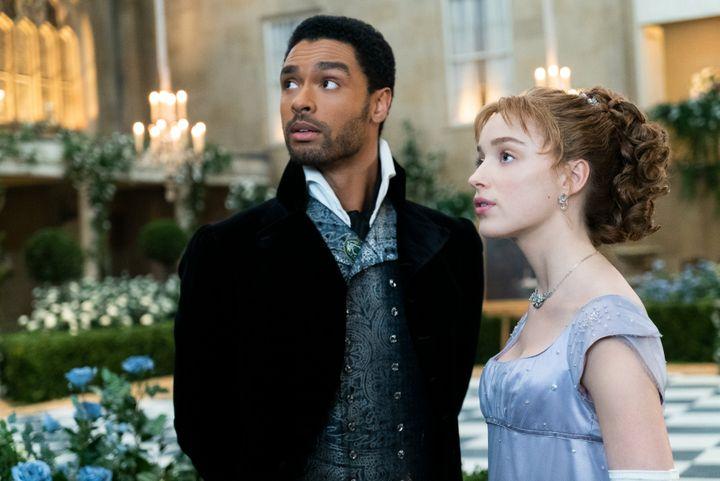 "Regé-Jean Page as the Duke of Hastings and Phoebe Dynevor as Daphne Bridgerton in Shonda Rhimes' ""Bridgerton"" on Netfl"