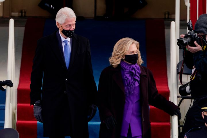 Former US President Bill Clinton arrives with former Secretary of State Hillary Clinton.