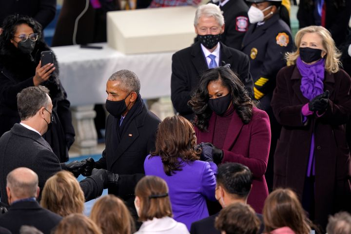 Note the pops of colour as Michelle Obama greets Kamala Harris, with Hillary Clinton looking on.