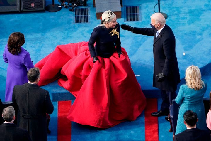 President-elect Joe Biden greets Lady Gaga during the 59th Presidential Inauguration at the US Capitol in Washington, January 20, 2021.