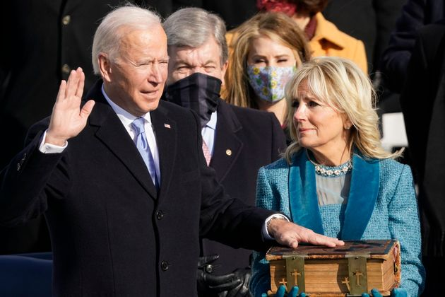 Joe Biden is sworn in as the 46th president of the United States by Chief Justice John Roberts as Jill...