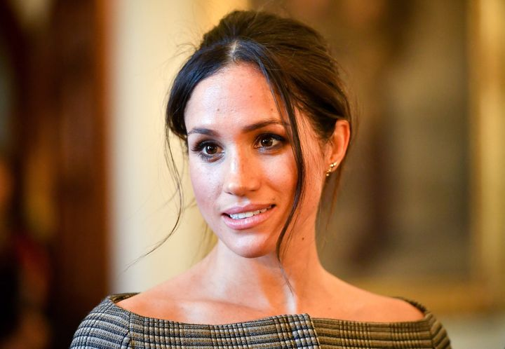 Meghan Markle chats with people inside the Drawing Room during a visit to Cardiff Castle on Jan. 18, 2018, in Cardiff, Wales.