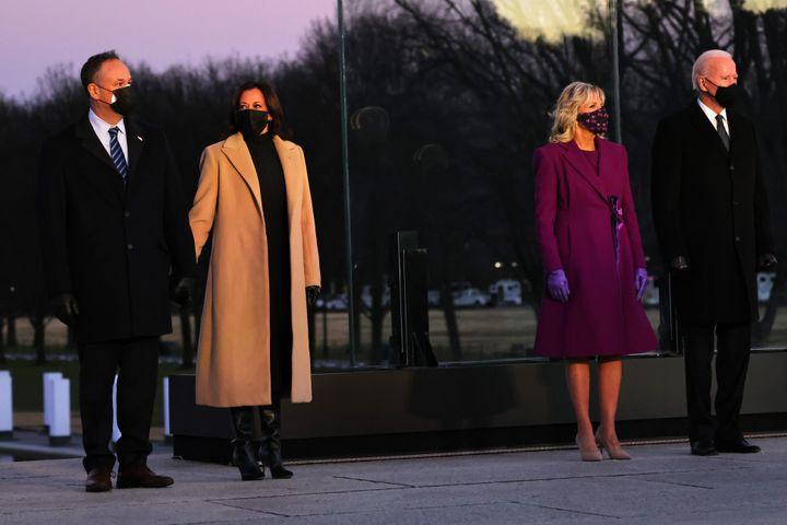 Doug Emhoff, Kamala Harris, Dr. Jill Biden and Joe Biden at a memorial for victims of the coronavirus pandemic at the Lincoln Memorial on Tuesday.