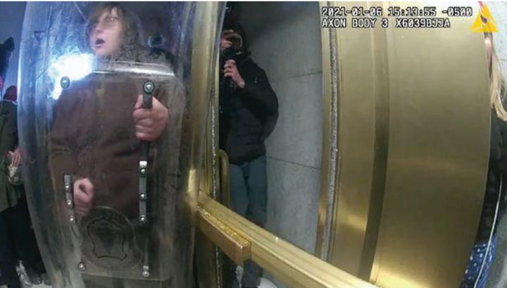 One YouTube video appeared to show McCaughey armed with a riot shield during the insurrection at the U.S. Capitol.