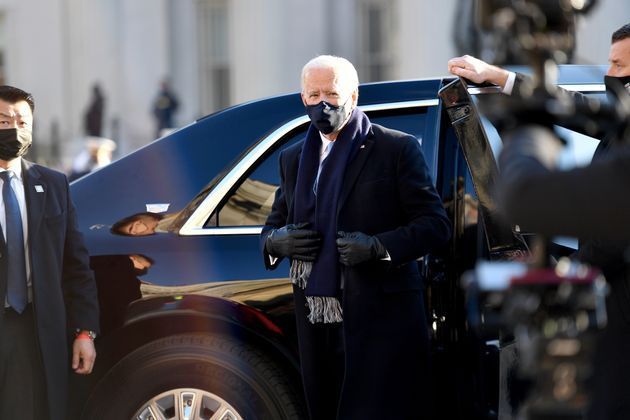 U.S. President Joe Biden prepares to walk the abbreviated parade route in front of the White House after...