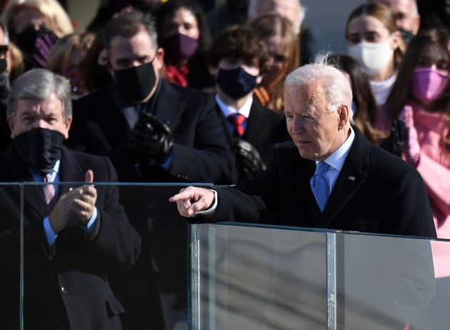 U.S. President Joe Biden acknowledges guests after delivering his inauguration speech on January 20,...