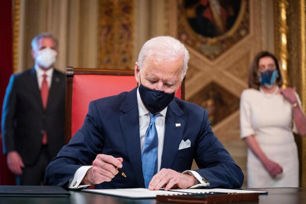 U.S. President Joe Biden signs three documents including an Inauguration declaration, cabinet nominations...