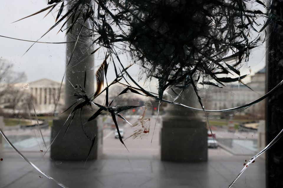 Riot damage is visible on the Rotunda doors of the U.S. Capitol in Washington, U.S. January 8, 2021....