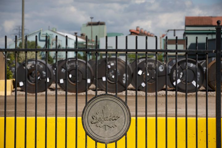 Steel coils are lined up behind the fence at the ArcelorMittal Dofasco steel plant on June 4, 2018 in Hamilton Ont.