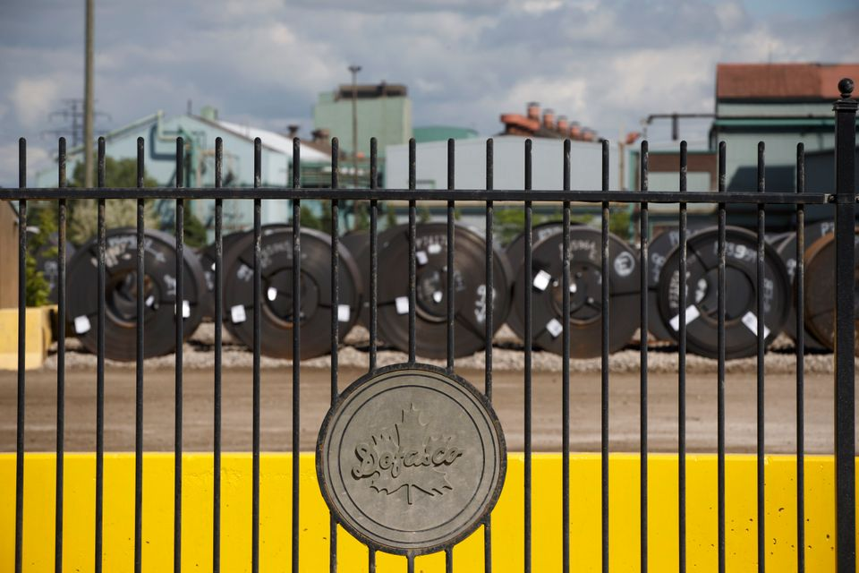 Steel coils are lined up behind the fence at the ArcelorMittal Dofasco steel plant on June 4, 2018...