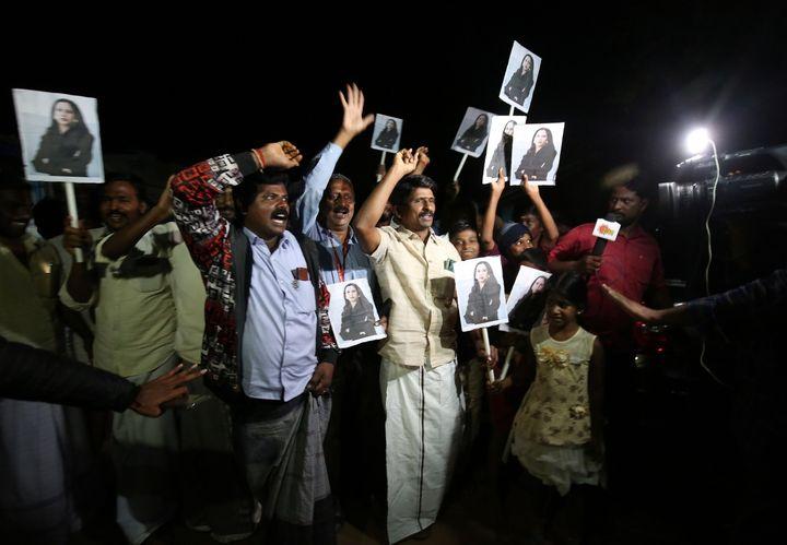 People celebrate in the village of Thulasendrapuram after Kamala Harris was sworn in as U.S. Vice President, on January 20, 2