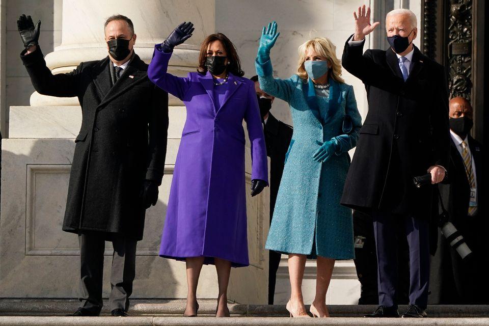 Joe Biden and his wife, Jill Biden, and Kamala Harris and her husband, Doug Emhoff, arrived at the steps...