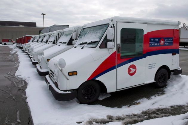 Canada Post trucks sit in a parking lot at the Gateway sorting facility in Mississauga, Ont., in December...