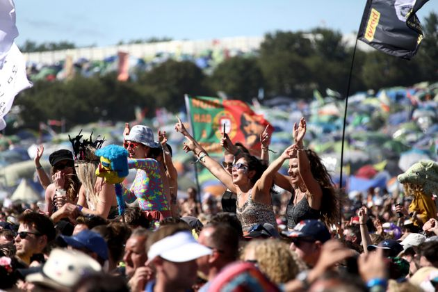 Festival-goers watch Kylie Minogue at the Glastonbury