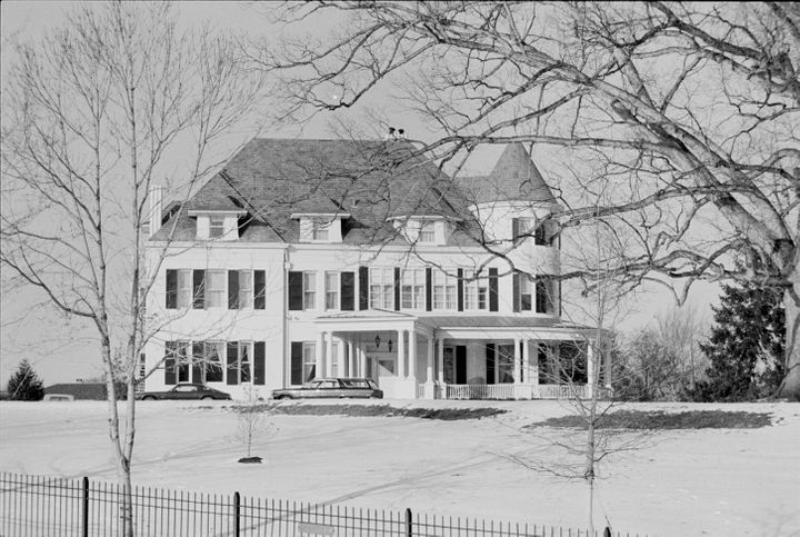 The house was painted white in the 1960s, as seen in this photo from January 1977.