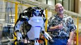 Marc Raibert, founder and chair of Boston Dynamics stands beside one of the company's Atlas robots during an interview and demonstration, Wednesday, Jan. 13, 2021, at their facilities in Waltham, Mass. The company engineered the robot to be able to dance in a fluid manner that is almost human. (AP Photo/Josh Reynolds)