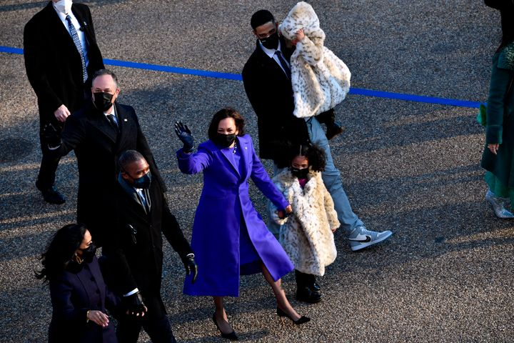 Vice President Kamala Harris walks with her family, including her niece's husband Nikolas Ajagu, during Wednesday's brief inaugural parade.