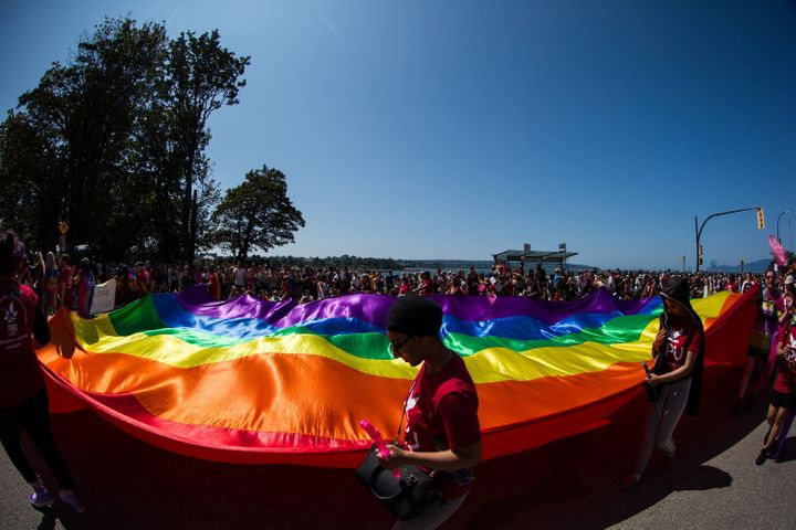 People carry a large rainbow flag during the Vancouver Pride Parade, on Aug. 4, 2019.