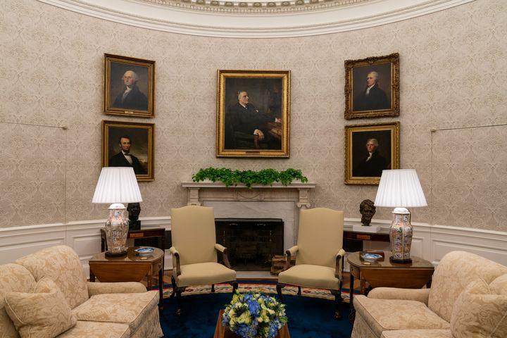 Portraits of former Presidents Franklin D. Roosevelt, Abraham Lincoln, George Washington and Thomas Jefferson, and Treasury Secretary Alexander Hamilton are seen in President Joe Biden's Oval Office.
