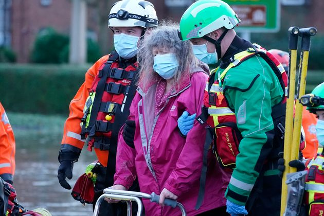 Elderly residents are evacuated from a local care home by emergency services in