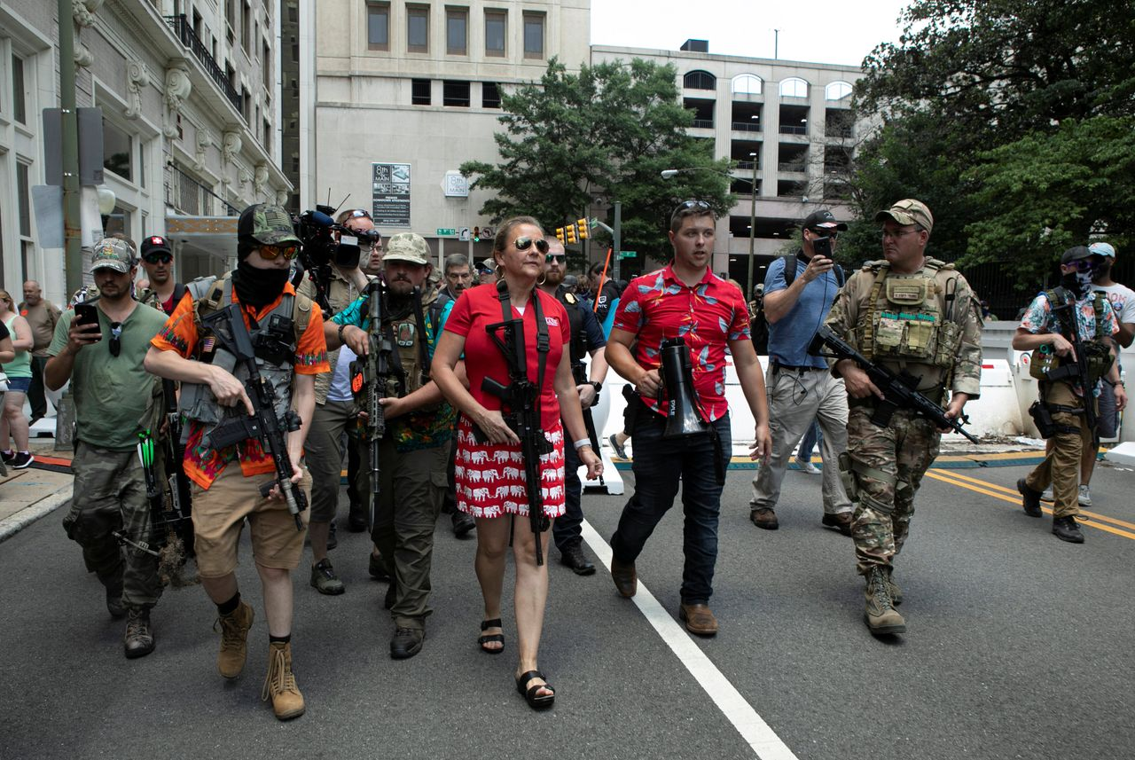 """Virginia state Sen. Amanda Chase walks through the crowd at a pro-gun rally in Richmond, Virginia, on July 4, 2020. She also joined the """"Stop the Steal"""" rally in Washington, D.C. on Jan. 6."""