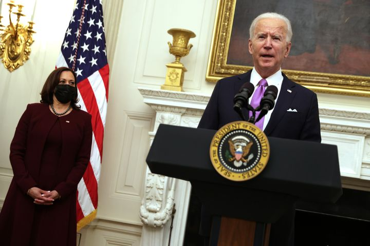 President Joe Biden, with Vice President Kamala Harris, speaks at the State Dining Room of the White House on Thursday about